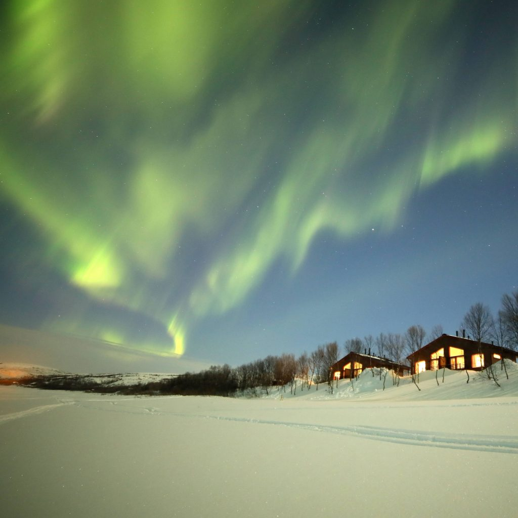 Riverside cabins and auroras